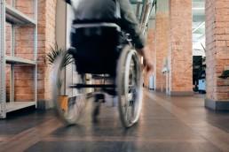 man in a wheelchair inside an office building